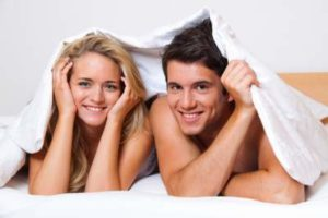 happy man and woman in bed